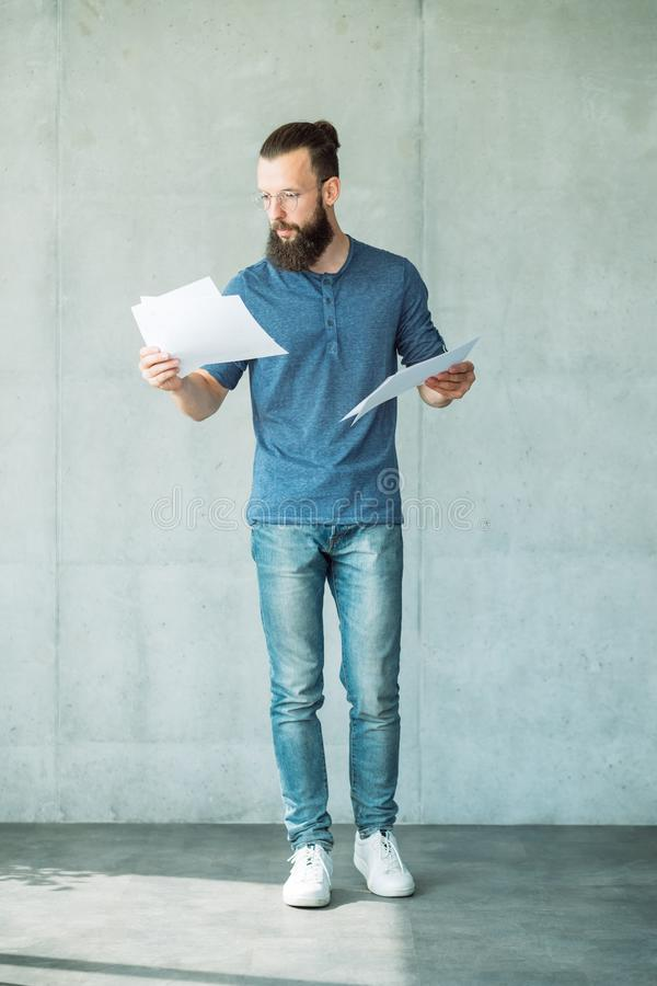 Man reading script papers focused screen writer royalty free stock images