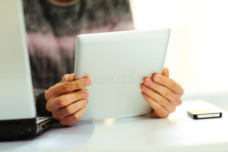 Download Man Reading On Tablet Computer Stock Image - Image: 35196443