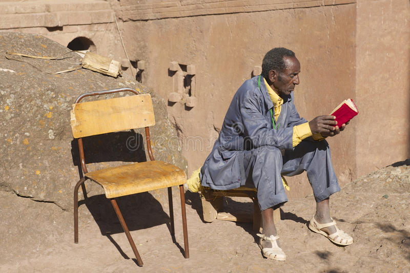 Man reads book in Lalibela, Ethiopia. stock images