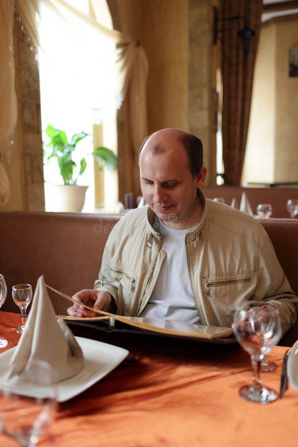 Download Man reads menu stock image. Image of looking, caucasian - 19415463
