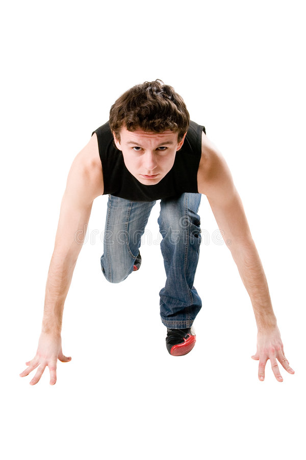 Man ready to run. Young man ready to run stock images
