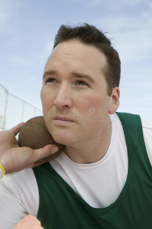 Man Ready To Throw Shot Put royalty free stock photography