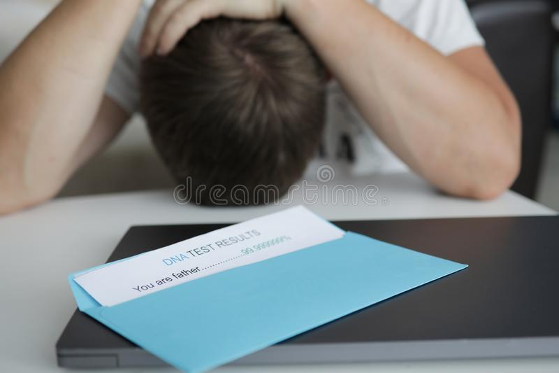 Man received letter in envelope with dna stock photo