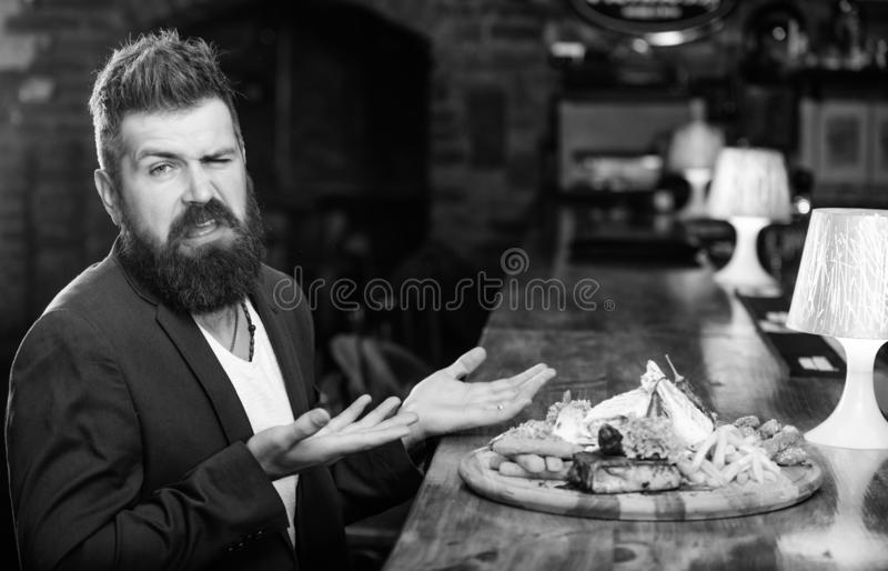 Man received meal with fried potato fish sticks meat. Delicious meal. Enjoy meal. Cheat meal concept. Hipster hungry eat royalty free stock photography