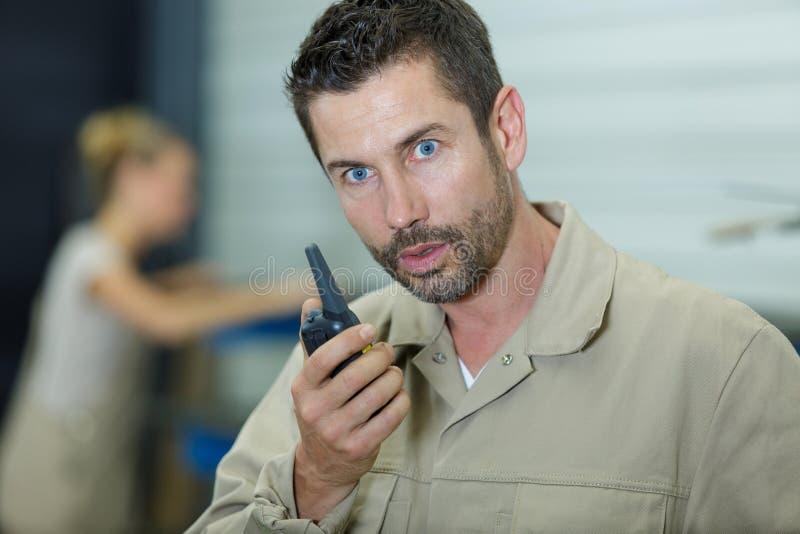 Man receivig shocking news via walkie talkie stock photography