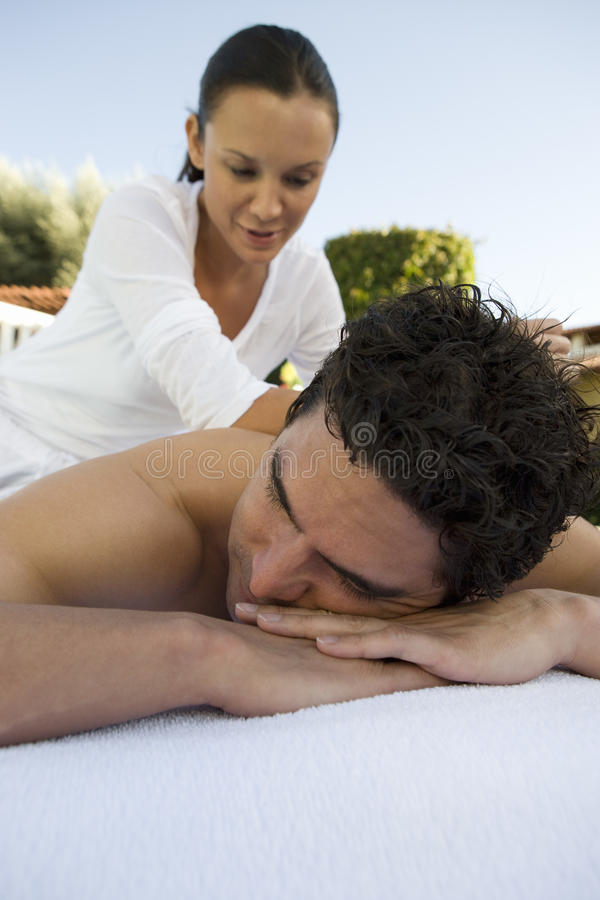 Man Receiving Back Massage By A Masseur stock photography