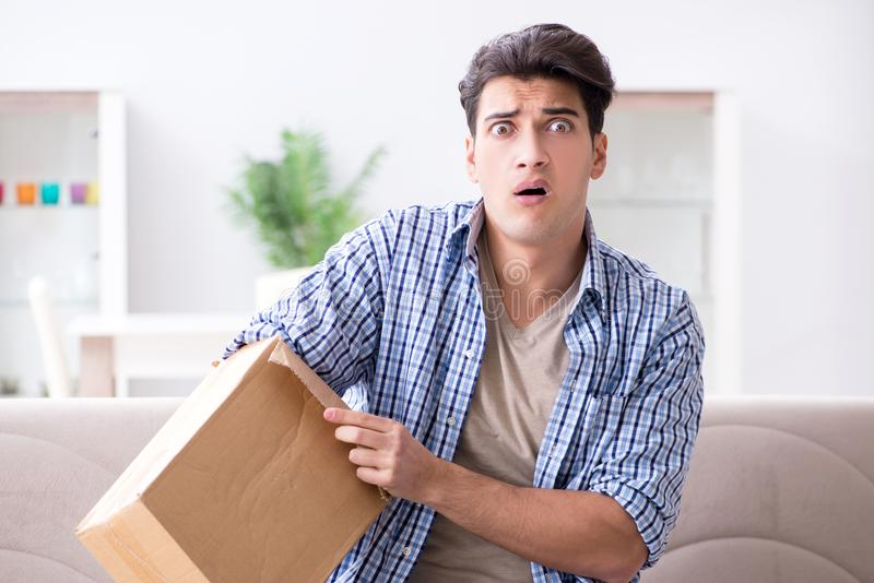 The man receiving empty parcel with stolen goods. Man receiving empty parcel with stolen goods royalty free stock photos