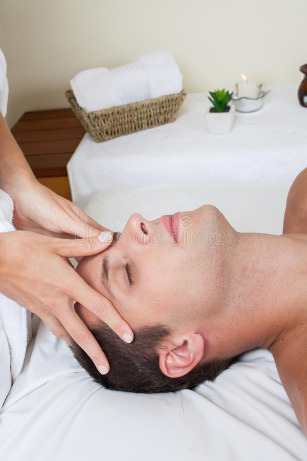 Man receiving massage stock photography