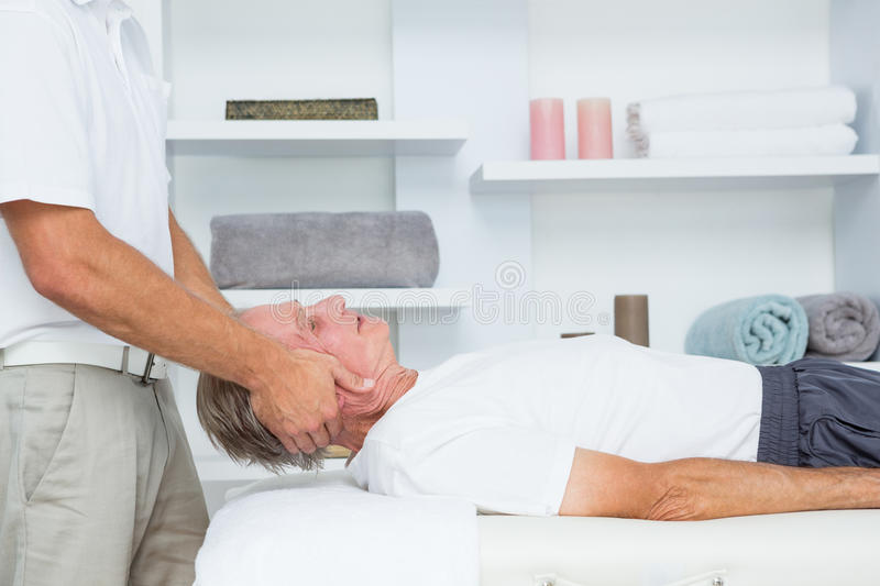 Man receiving neck massage. In medical office royalty free stock photography
