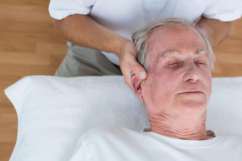Man receiving neck massage stock images