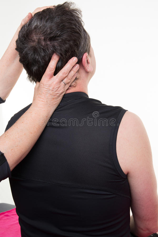 Man receiving neck massage in a medical office. Man is receiving neck massage in a medical office royalty free stock photography