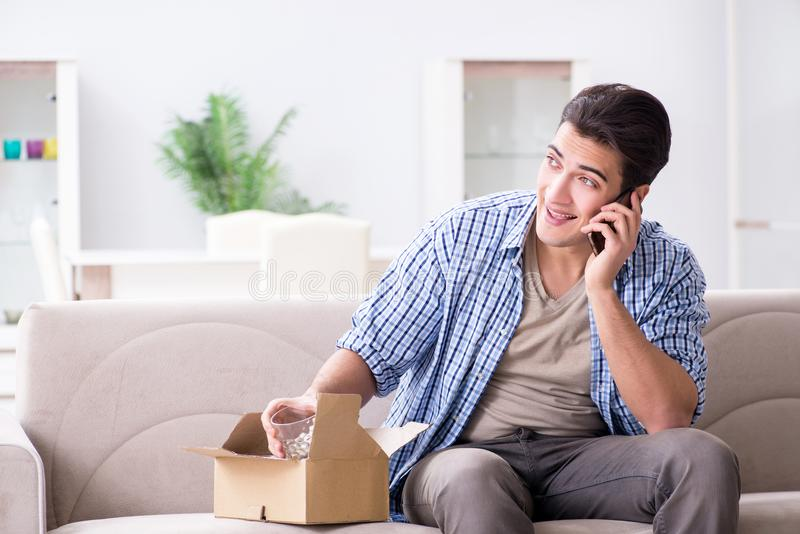 The man receiving parcel at home. Man receiving parcel at home stock photo
