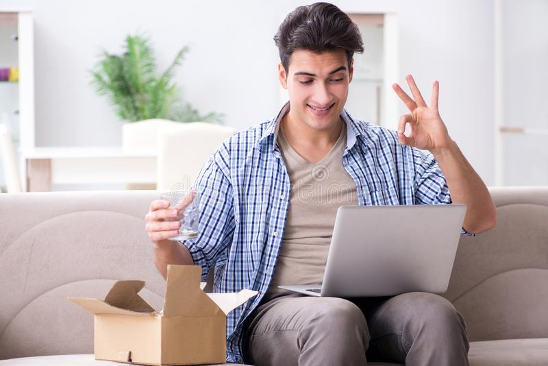 The man receiving parcel at home. Man receiving parcel at home stock image