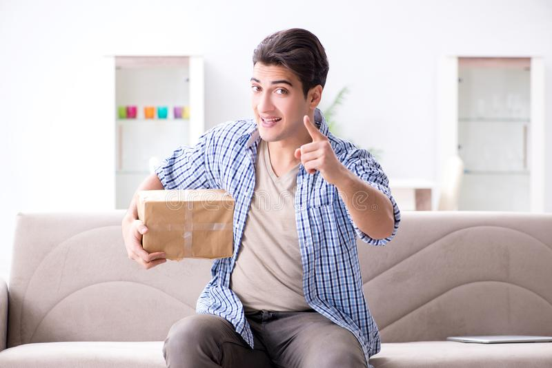 The man receiving parcel at home. Man receiving parcel at home royalty free stock photo