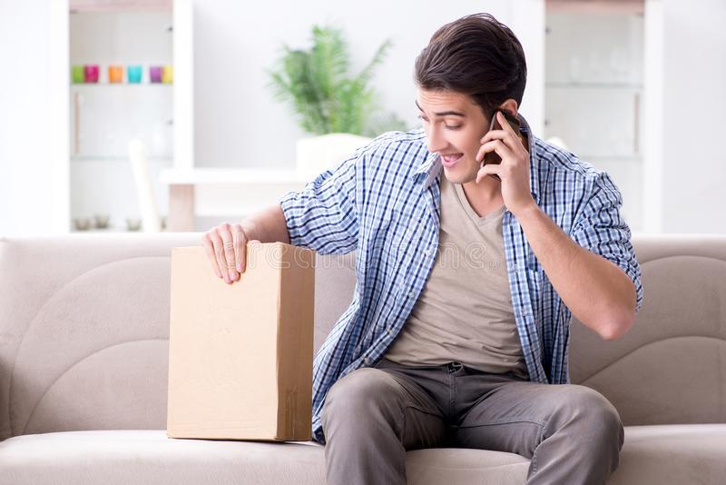 The man receiving parcel at home. Man receiving parcel at home stock photography