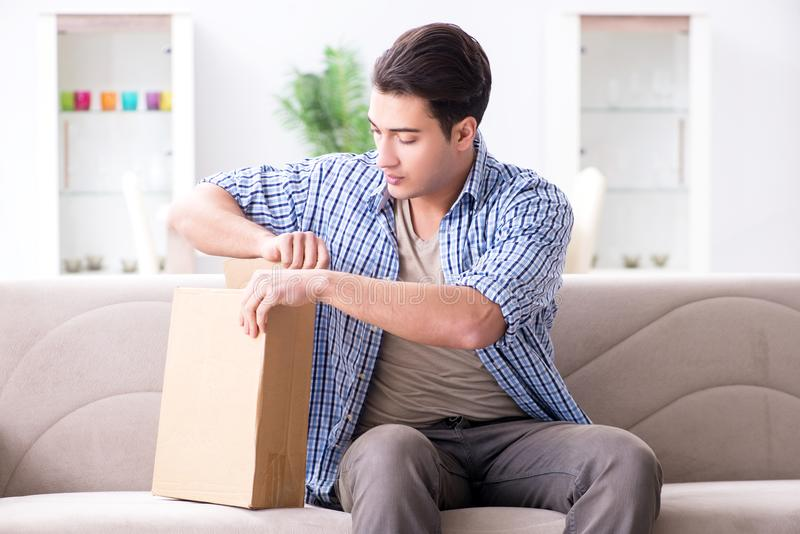 The man receiving parcel at home. Man receiving parcel at home royalty free stock images
