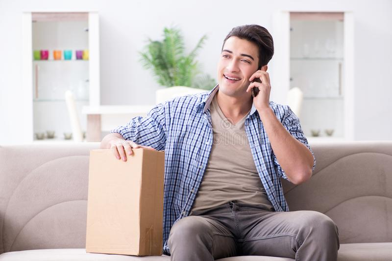 The man receiving parcel at home. Man receiving parcel at home royalty free stock photography