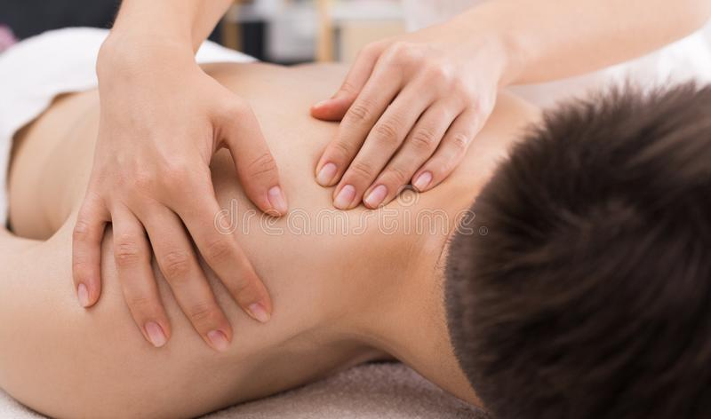 Man receiving relaxing back massage in spa royalty free stock photo