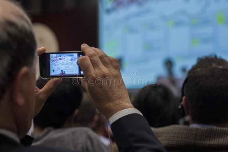 Man recording event on smartphone stock image