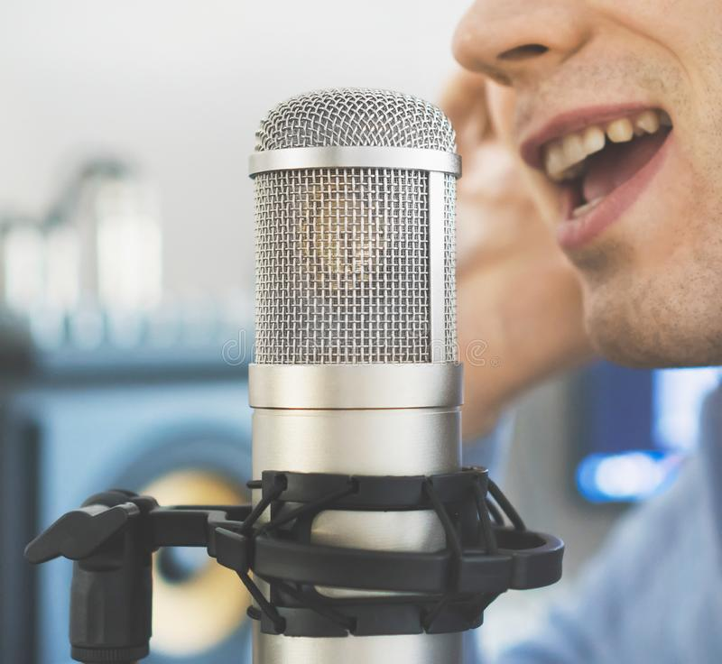 Man recording a song. Man recording a song in record studio royalty free stock image