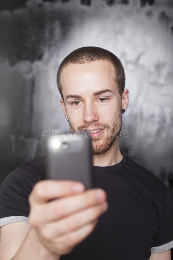 Download Man Recording Video With Smartphone Stock Photo - Image: 25219190