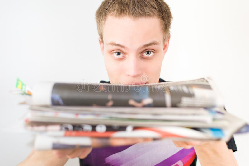 Man recycling old newspapers royalty free stock photo
