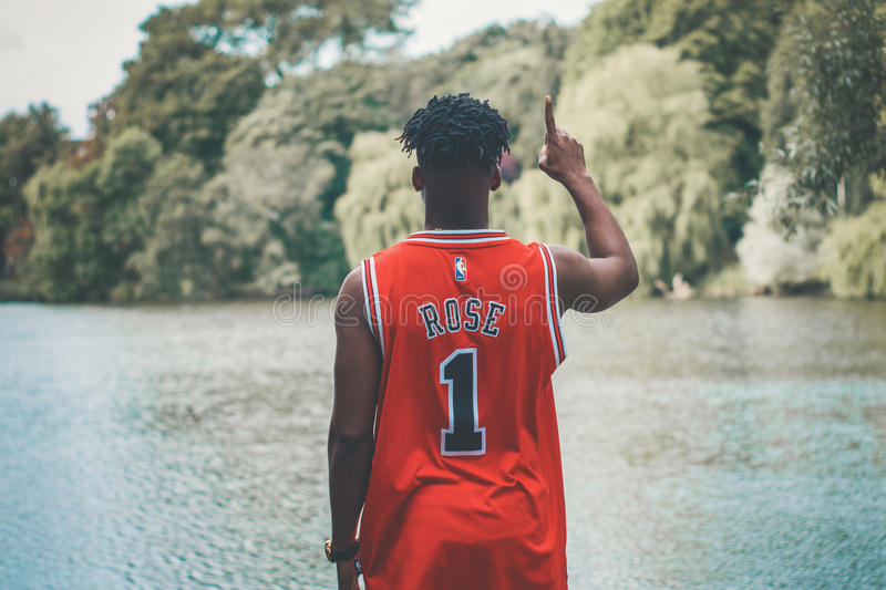 Man In Red #1 Basketball Jersey Pointing Up Standing In Front Of River At Daytime Free Public Domain Cc0 Image