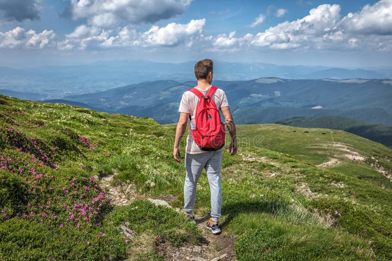 Guy man with backpack lost mountains summer hike trip outside. Guy man with backpack lost in mountains summer hike trip outside stock image