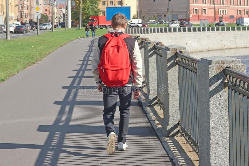 A man walking along the quay of the canal royalty free stock image