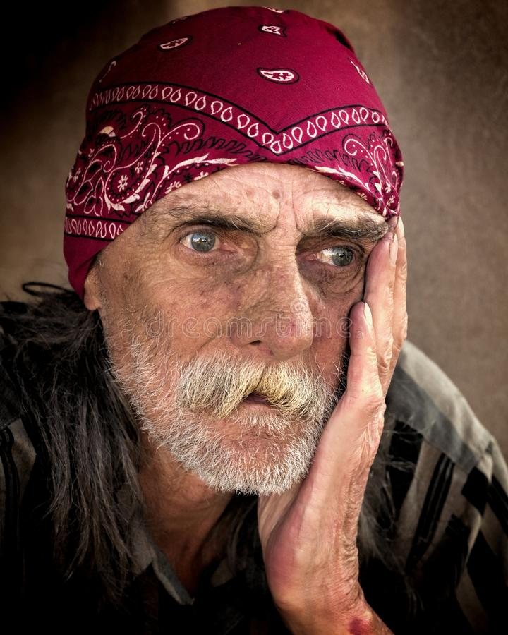 Man in red bandanna stock image