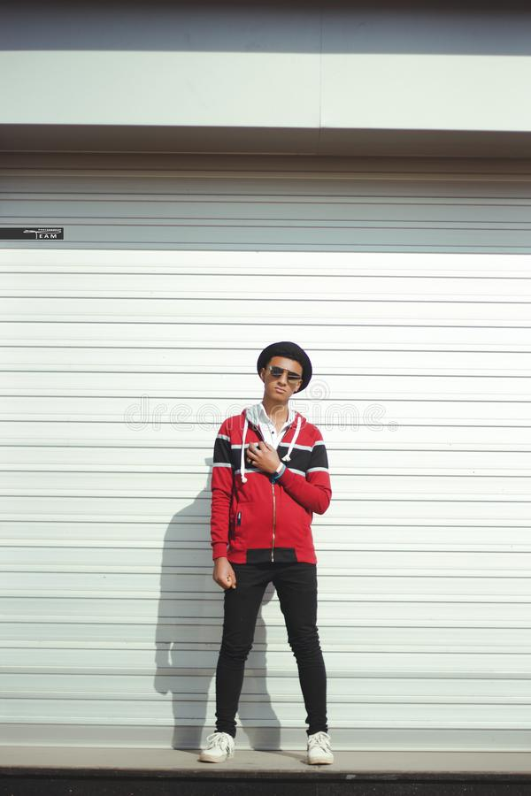 Man In Red And Black Zip-up Jacket And Black Pants With Black Hat stock images