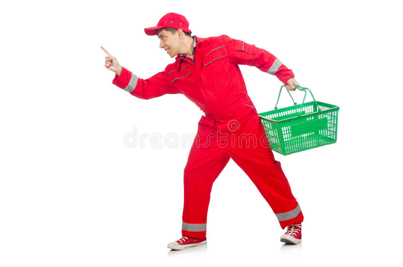 Man in red coveralls. With shopping supermarket cart trolley royalty free stock images