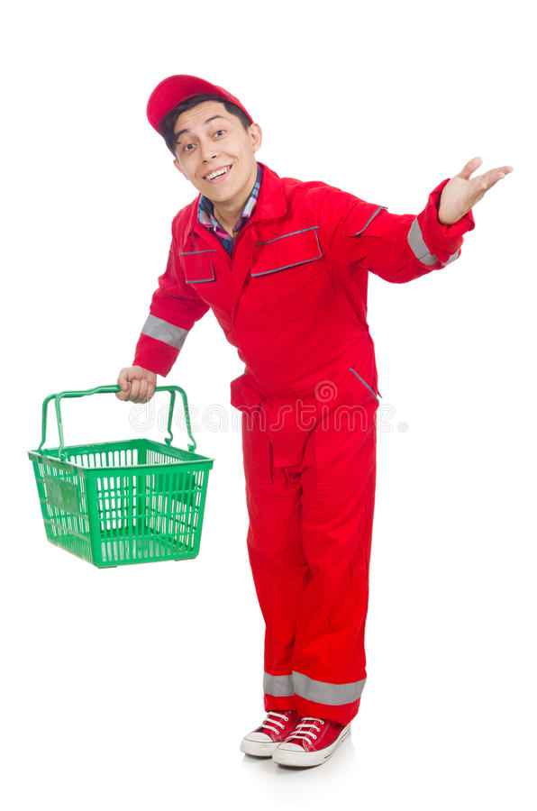Man in red coveralls. With shopping supermarket cart trolley royalty free stock photo