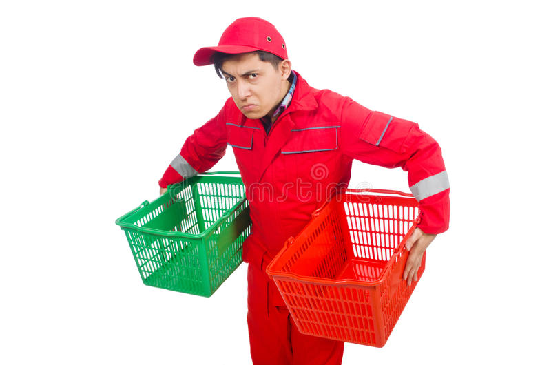 Man in red coveralls. With shopping supermarket cart trolley stock photo
