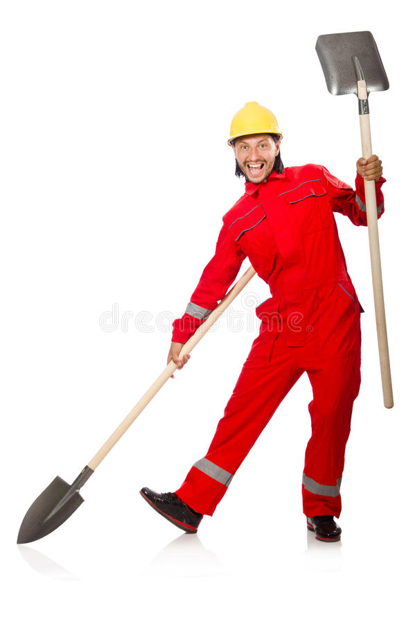 Man in red coveralls. With spade royalty free stock images