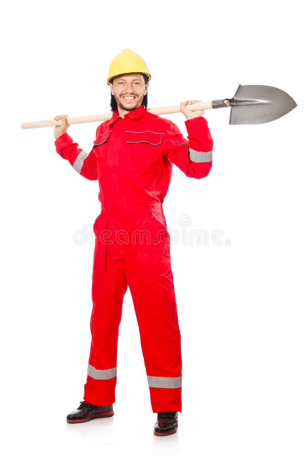 Man in red coveralls. With spade royalty free stock image