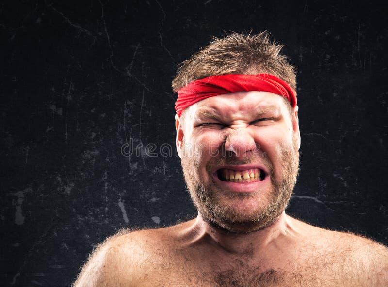 Man with red headband royalty free stock photo