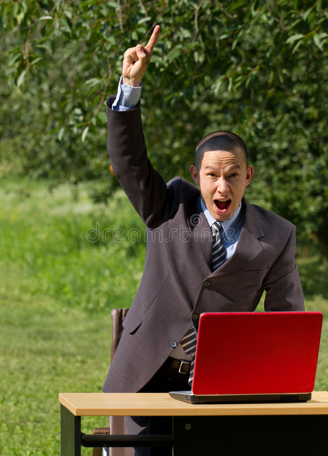 Man With Red Laptop Working Outdoors Royalty Free Stock Photo