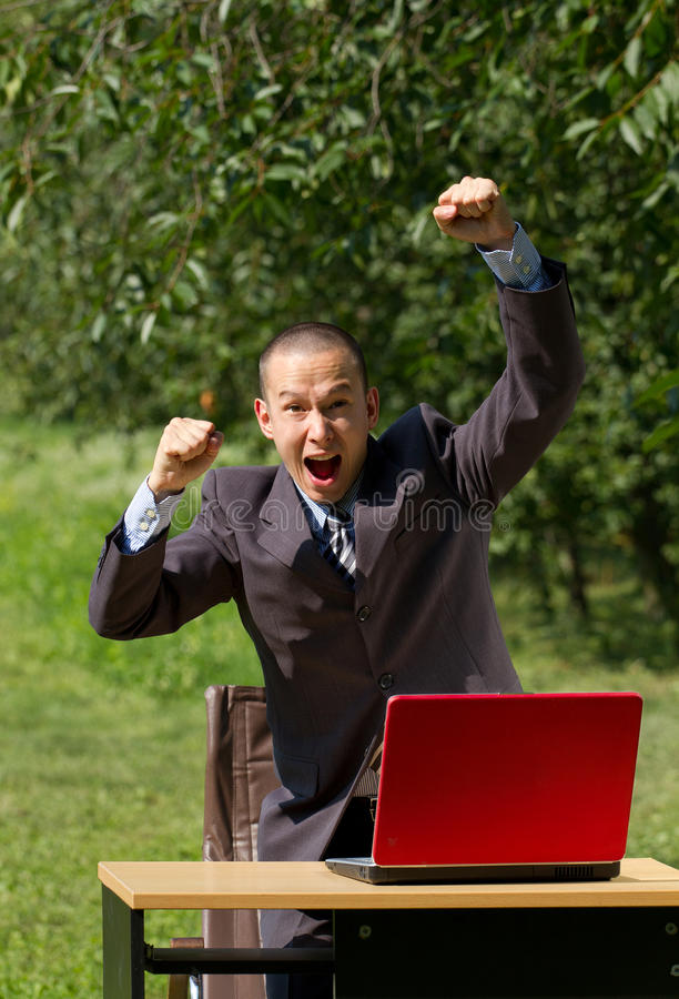 Download Man With Red Laptop Working Outdoors Stock Photo - Image: 20381084
