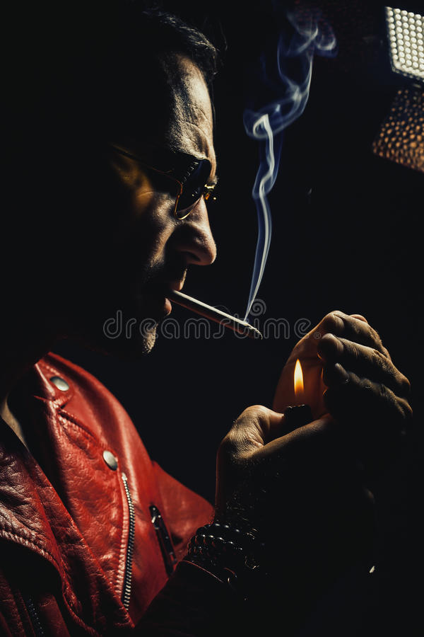 Man in Red Leather Jacket With Cigar stock photo