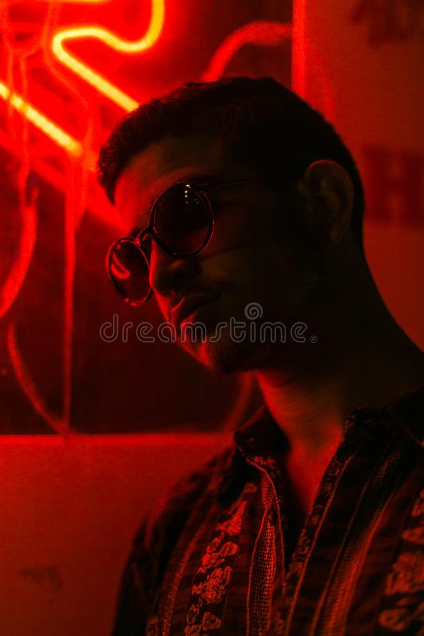 Man in a red-lit room stock photo