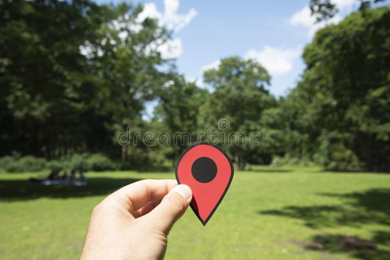 Man with a red marker at Tiergarten park in Berlin. Closeup of the hand of a young caucasian man with a red marker in the popular Tiergarten public park in royalty free stock photography