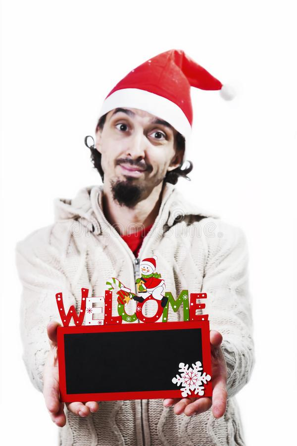 Man with santa hat holding a black board stock images