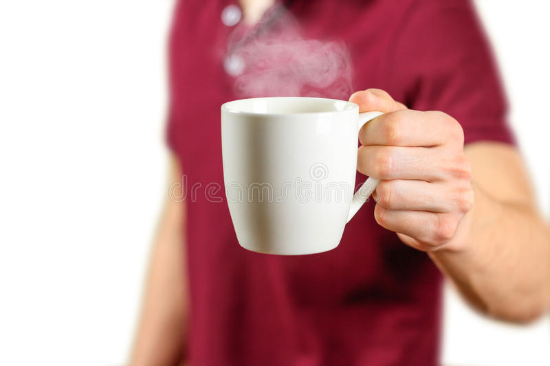 The man in the red shirt shows a clean white Cup. Cup for your design royalty free stock image