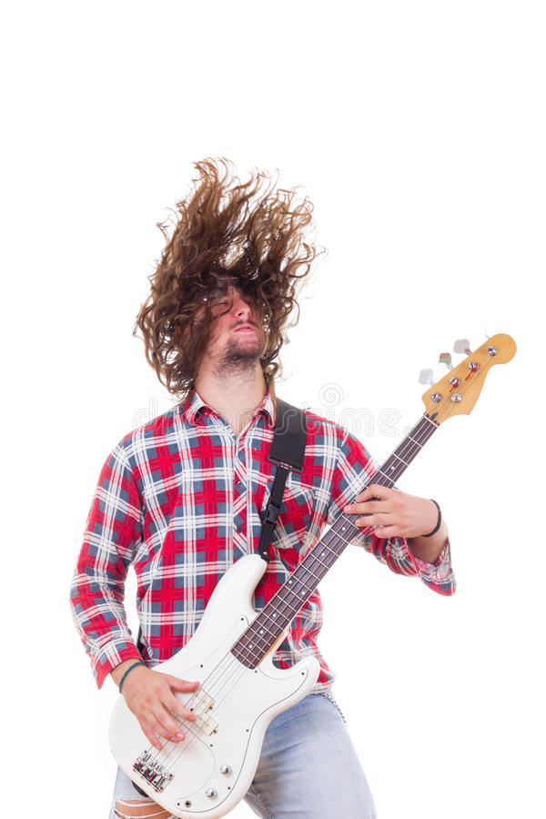 Man in red shirt with tousled hair playing electric bass guitar royalty free stock images
