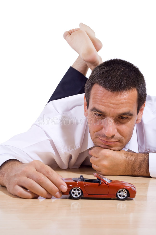 Download Man with red toy car stock image. Image of conceptual - 5834565