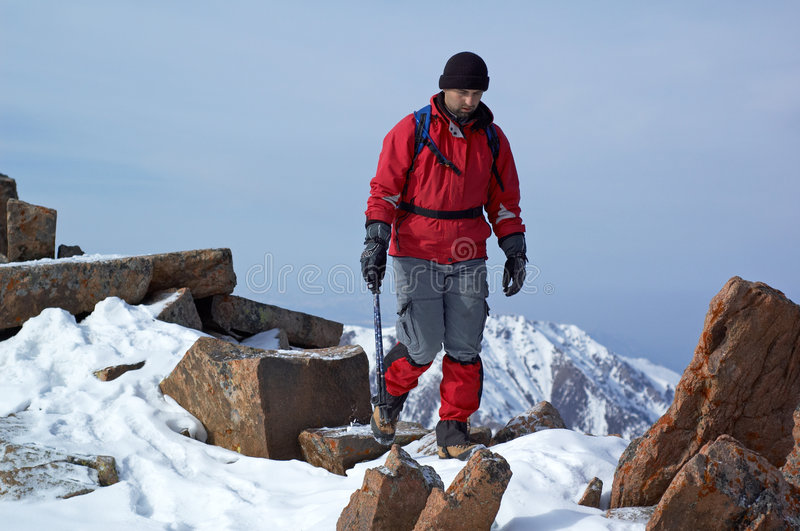Download Man In Red Travels In Mountains Stock Image - Image: 3933641