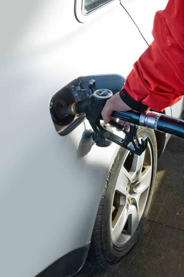 Man refilling petrol deposit royalty free stock photo