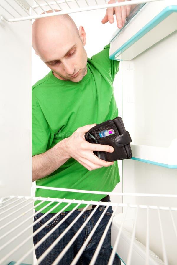 Man refrigerator wallet stock photo
