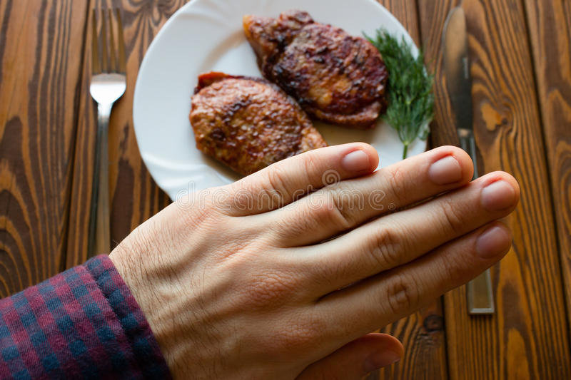 Man refuses to grilled meat. Close up stock photo